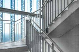 commercial building concrete stairs and metal hand rail